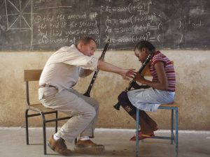 Gary Sperl teaching beginning clarinet at Korongoni Secondary School