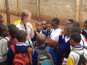 Collegiate volunteer Katie Kessler teaching a beginning clarinet student