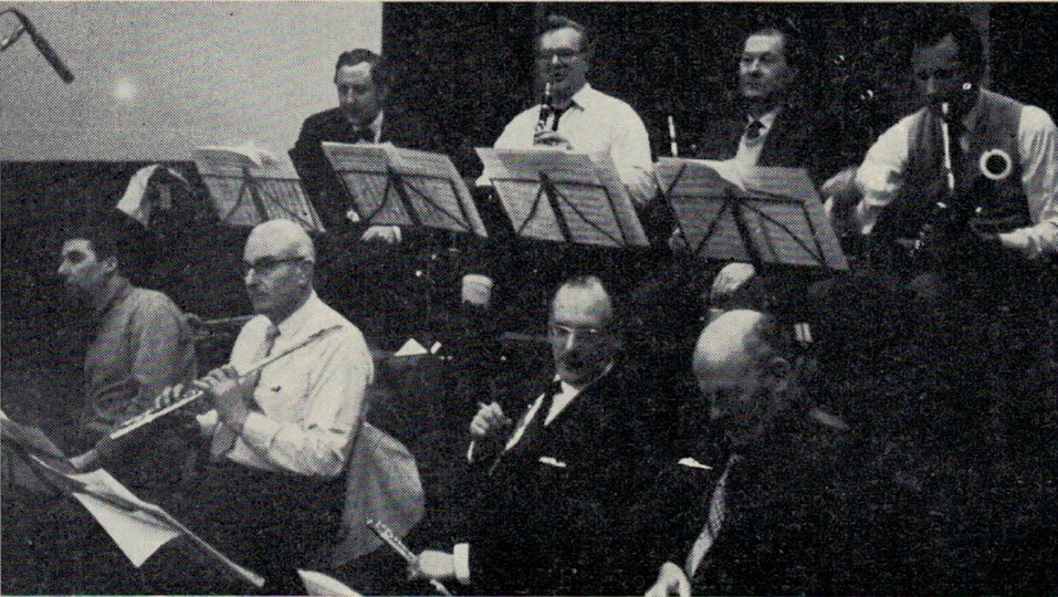 First-call London studio musicians recording with Quincy Jones, Henry Mancini and conductor Bob Farnon in April 1964; back row (left to right): Frank Reidy, Bob Burns (clarinet), Cecil James, Anthony Judd (bassoons); front row: Johnny Scott, Phil Goody, Geoffrey Gilbert (flutes), Leon Goossens (oboe). Photo courtesy of National Jazz Archive, Great Britain