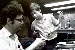 Scott explains an instrument repair to young students (Interlochen Music Camp - 1981)