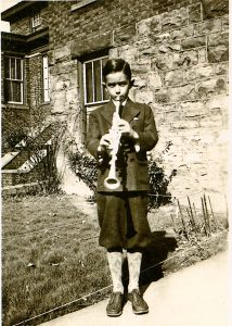 A young Rubin poses with his metal clarinet
