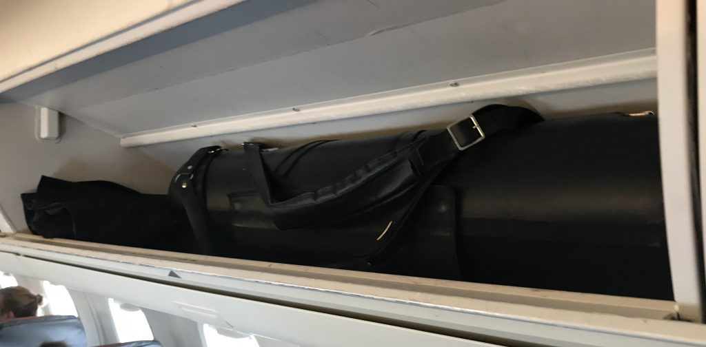 Wiseman Model A bass clarinet case in the overhead bin of the small Embraer 145 Canadian regional jet (American Airlines)